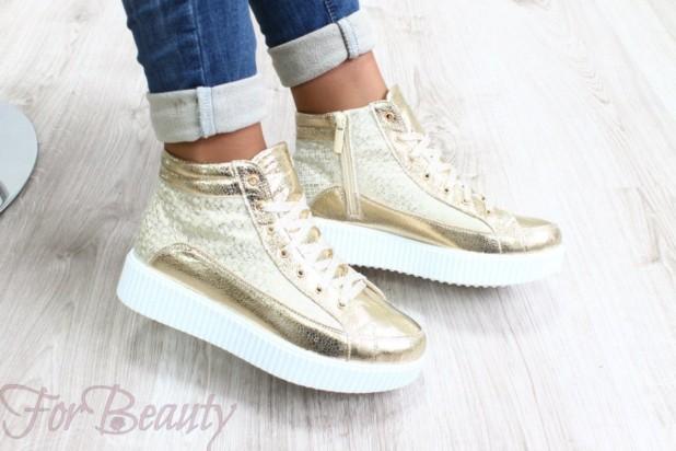 Модные золотые кроссовки с высокой подошвой
