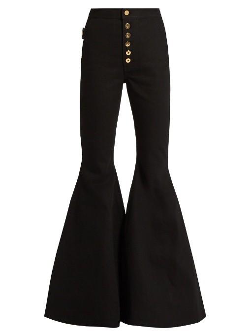 женские джинсы: черные клёш