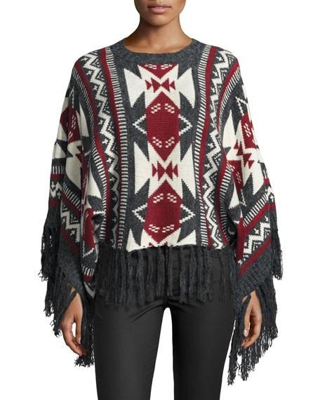 женский вязанный свитер с бахромой