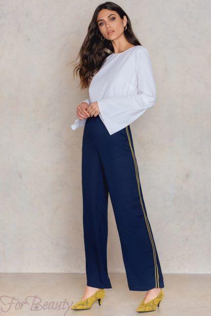 брюки женские 2019 года модные тенденции фото: широкие с лампасами